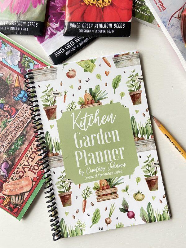 kitchen garden planner on a white table